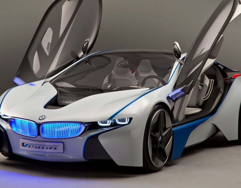 White BMW Vision GT Car With Its Doors Open And Open Blue Headlights