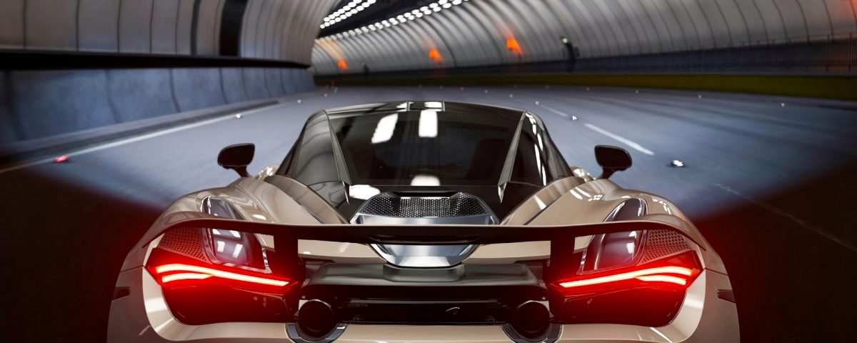 Mclaren 720S White Car Rear View In Underpass With Its Back Lights On