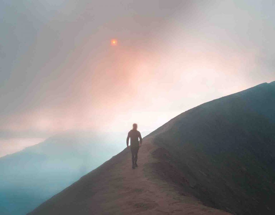 Man Walking On Mountain Alone