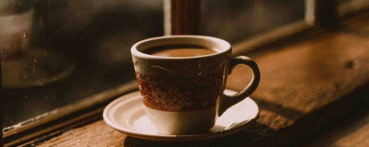 Coffee In A Cup On Saucer Near The Window