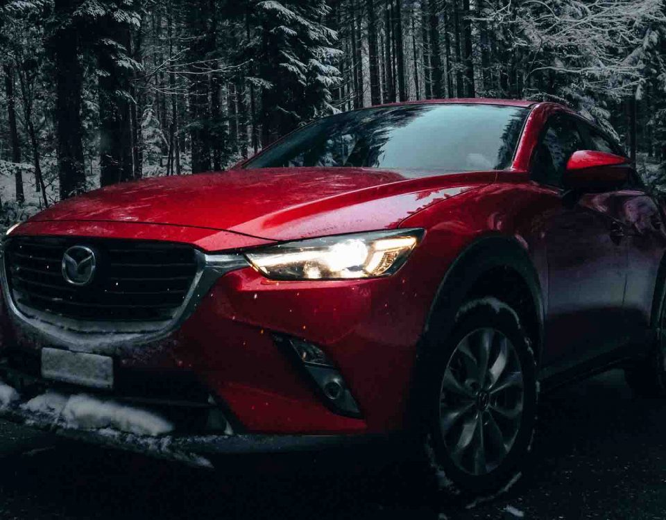 Red Mazda 6 Car Model 2015 Standing On Road Full Of Snow Between Trees