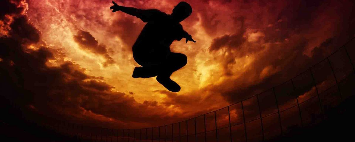 Parkour Silhouette On Red And Golden Sky