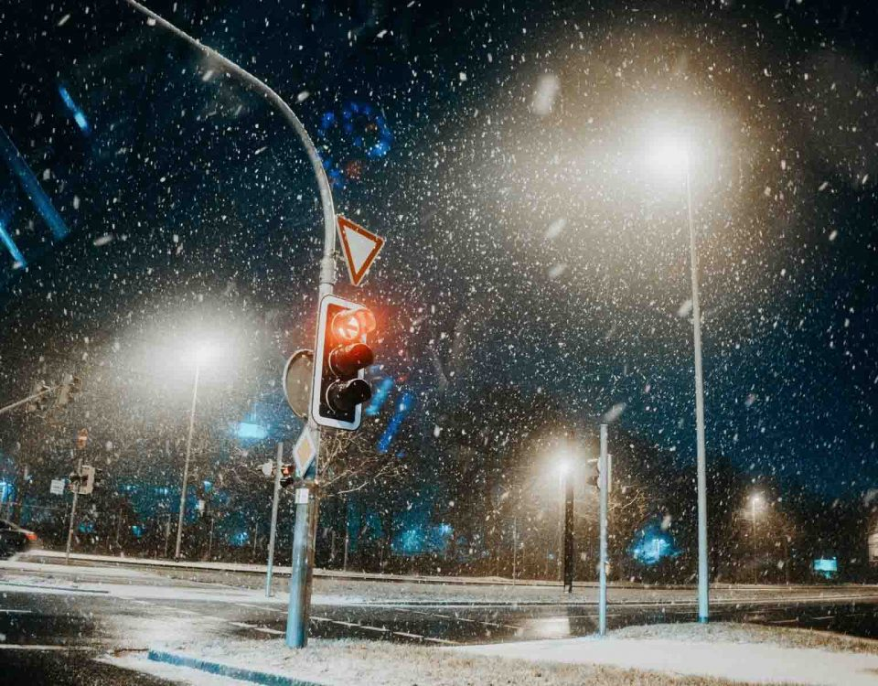 Snow Falling On Road, Signals And Street Lights