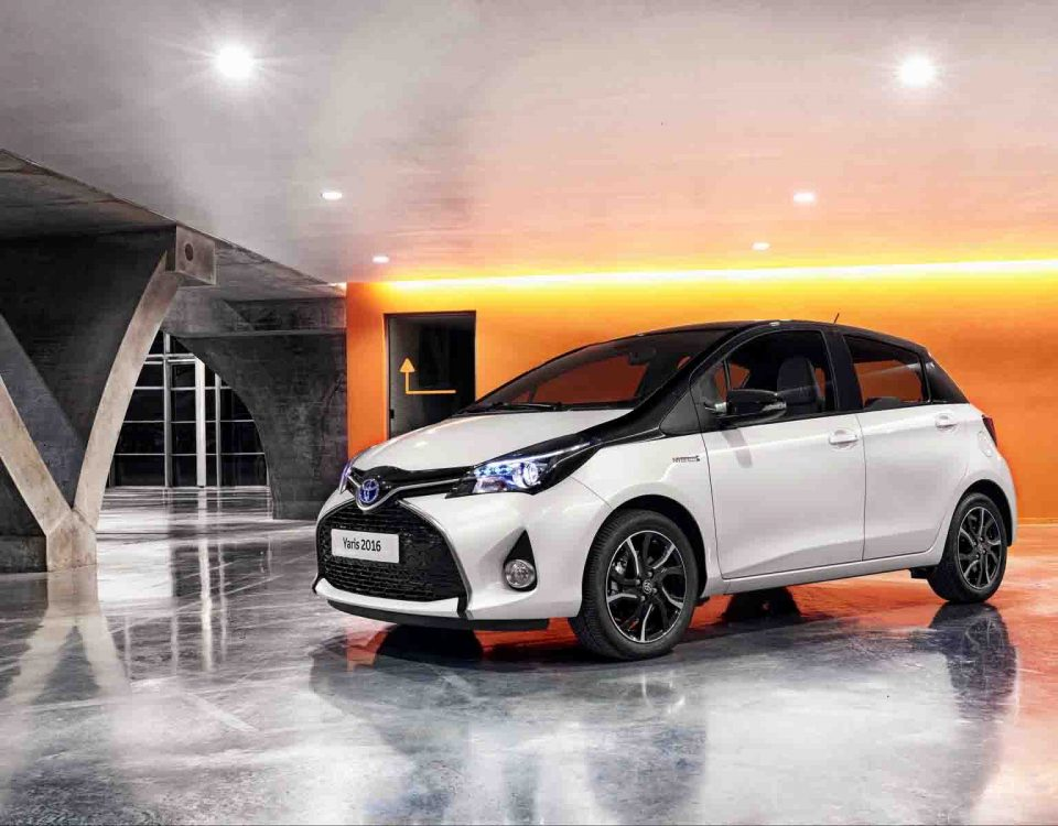 White Car Toyota Yaris Model 2018 Standing In A Showroom