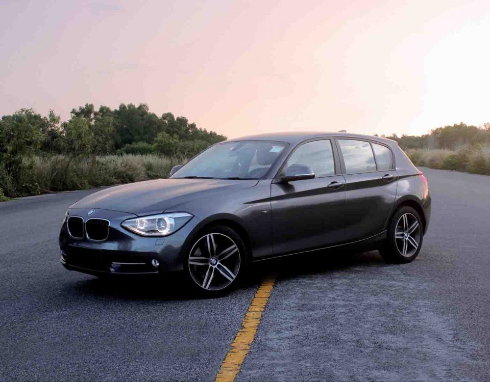 Black BMW 2006 Car Model 118 Standing On Road Side View