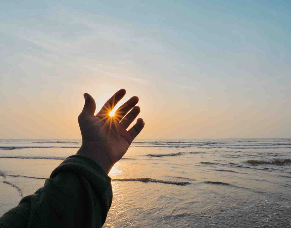 A Hand Of Man In Front Of The Sun
