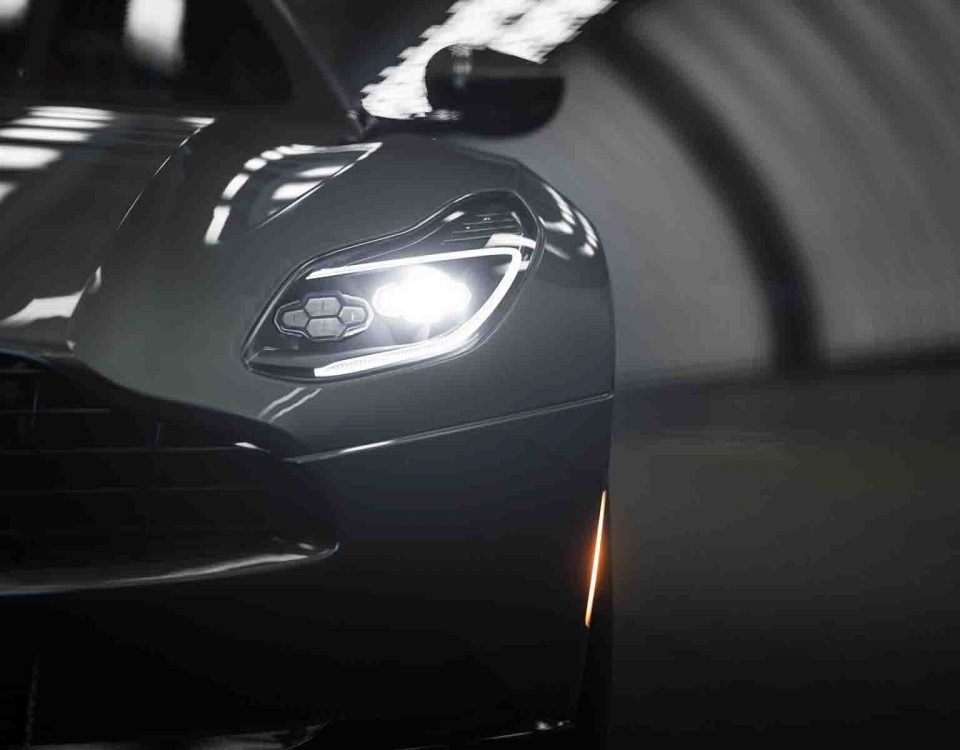 Aston Martin Black Car Model DB11 Close Up With Its Headlights On