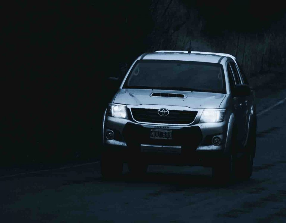 Hilux Car With Its Headlights On In Night On Road