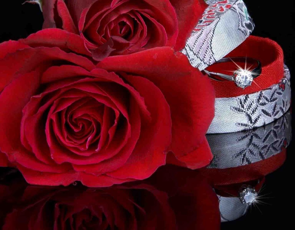 Reflection Of Ring With Rose And Box